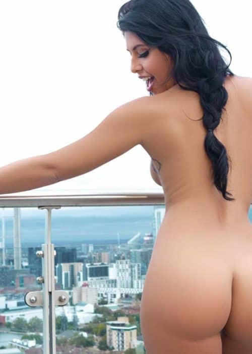 Elena Standing Fully Nude Showing Her Butt with Arms at Her Side on the Balcony.